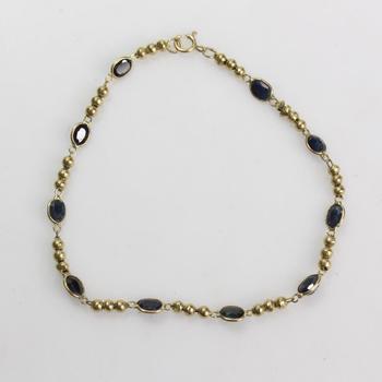 17k Gold 3.10g Bracelet With Dark Blue Stones