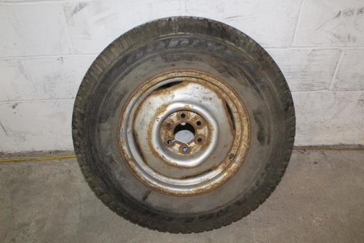 "Goodyear Wrangler Tire With 15"" Rim"