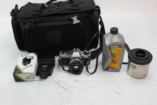 Olympus OM10 35mm SLR Camera With Camera Bag And Other Accessories
