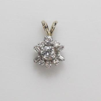 Platinum And Gold .74ct T.W. Diamond Pendant