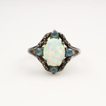 Silver Iridescent Ring With Blue Stones