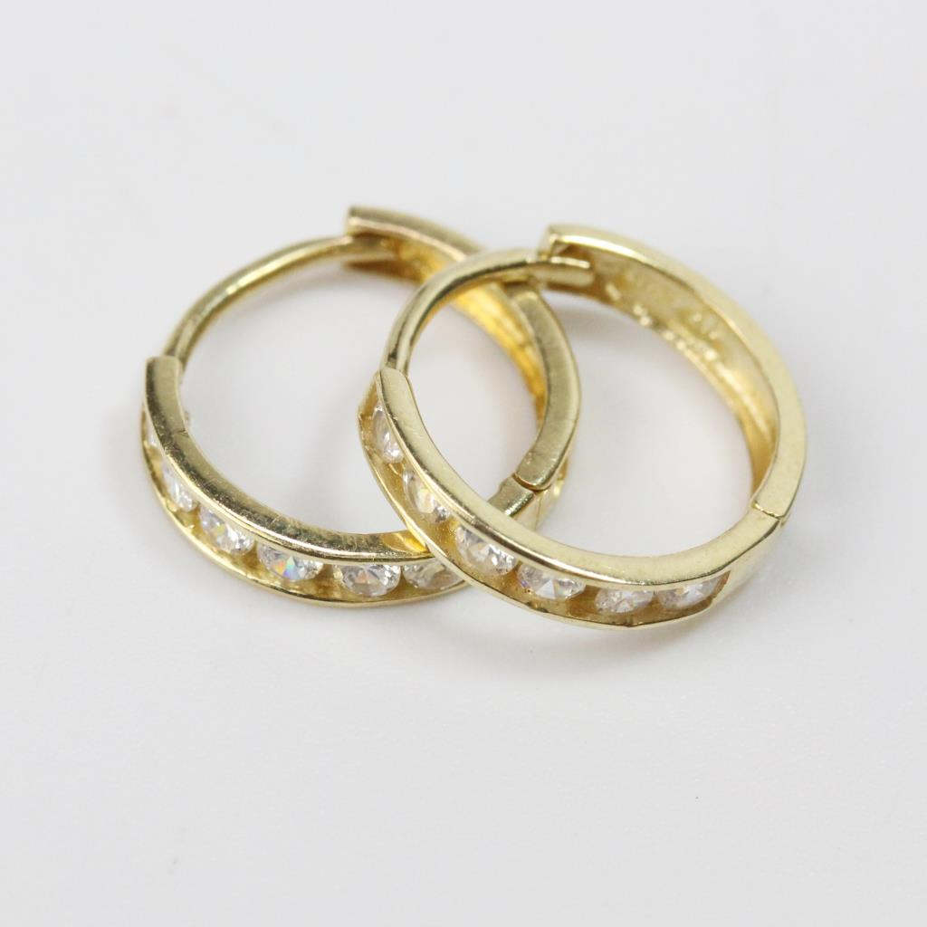 0050444f13ff3 14tk Gold 0.83g Pair Of Hoop Earrings With Clear Stones | Property Room