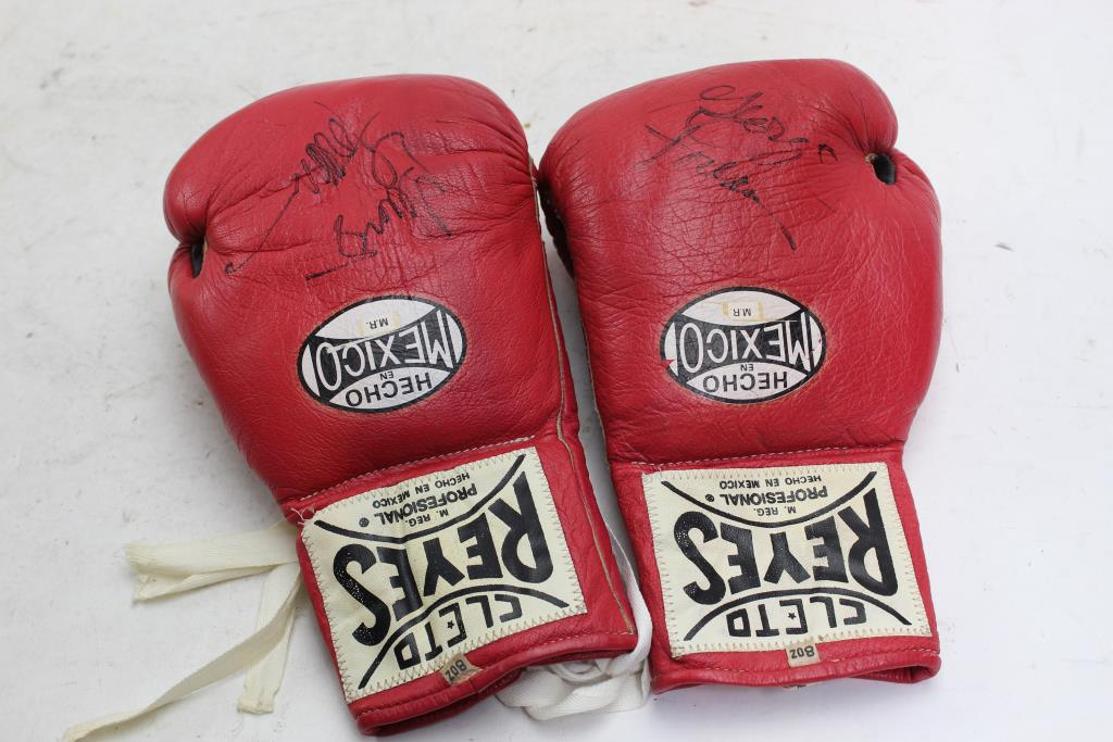 George Foreman Signed Cleto Reyes Boxing Gloves | Property Room