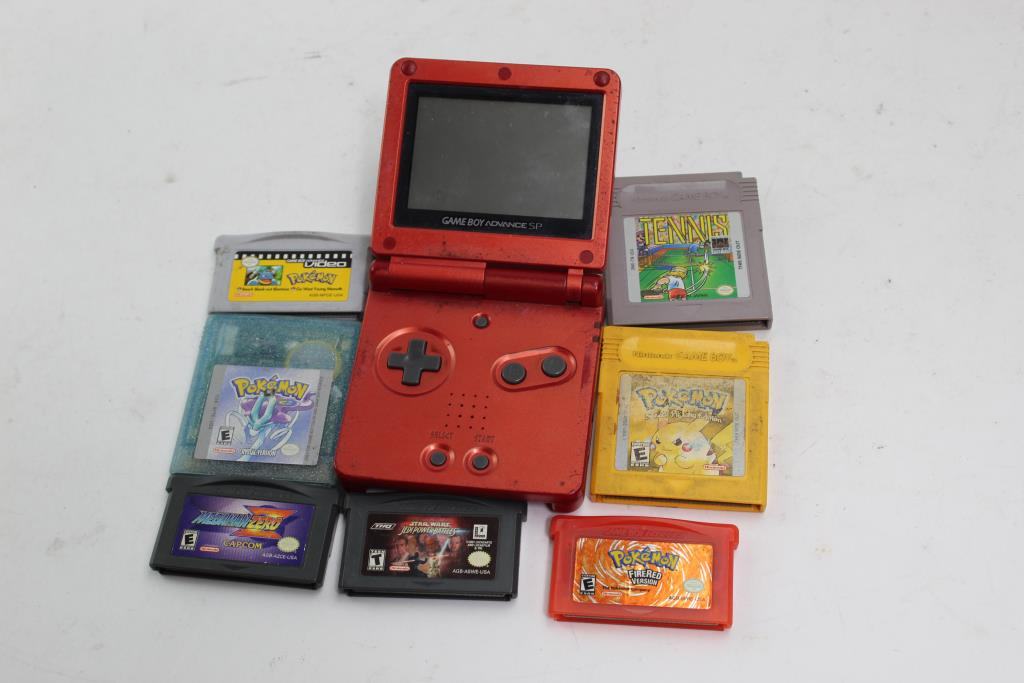 nintendo gameboy advance sp with assorted games 8 pieces property
