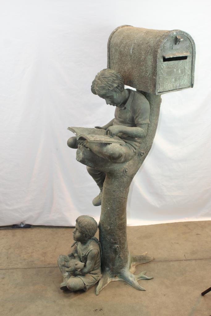 outside mailbox boy reading a book girl with a teddy bear