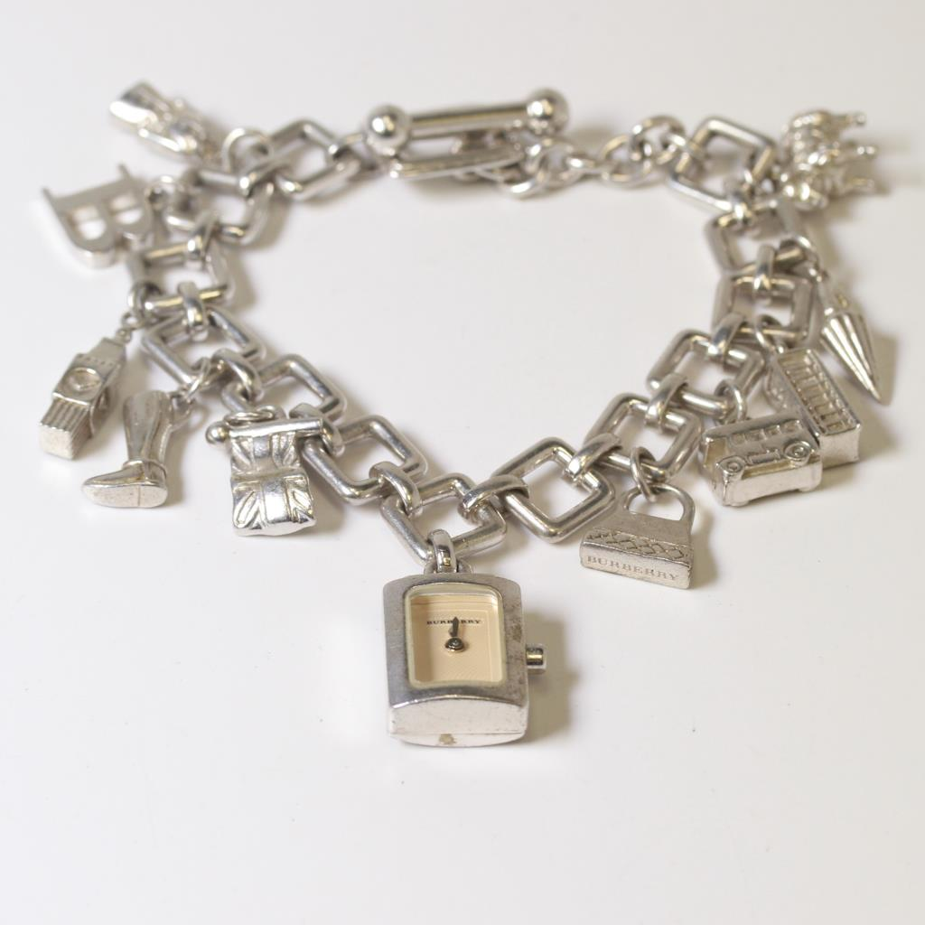 Charm Bracelet Watches: Women's Burberry Sterling Silver Charm Bracelet Watch