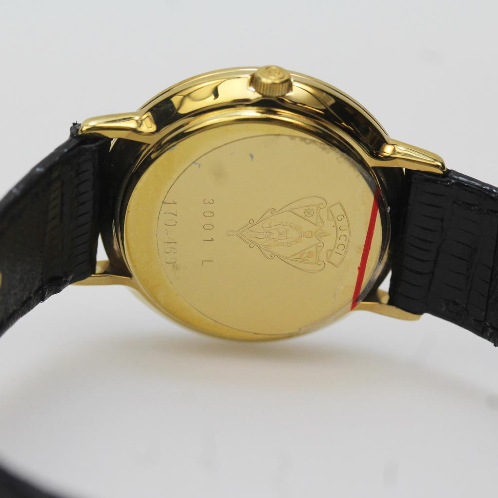 76d21272294 Women s Gucci 18kt Gold Plated Black Leather Watch