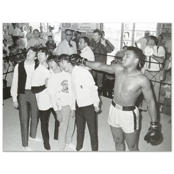 "Muhammad Ali and the Beatles. Licensed Photograph of the Heavyweight Champ (40"" x 30"")."