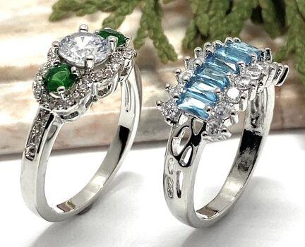2PC Ring LOT - 1.33ctw Emerald & White Sapphire 3 Stone Ring Sz 7 & 1.76ctw Blue Topaz & White Sapphire Ring Sz 7