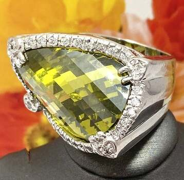 .925 Sterling Silver, 15x23mm Peridot & 0.50ctw White Topaz Ring Size 7