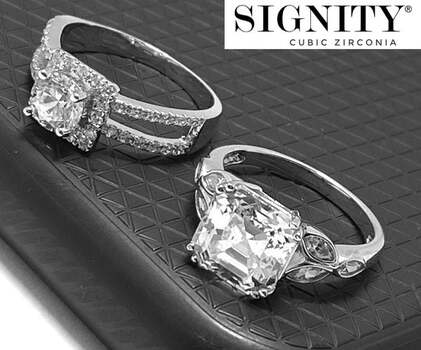 """.925 Sterling Silver, 7.25ct """"SIGNITY STAR"""" Cubic Zirconia Lot of Two Rings Sizes 6 & 7"""