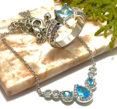 Lot of 1.78ctw Blue Topaz Ring Size 8 & 1.40ctw Blue Topaz and White Topaz Necklace