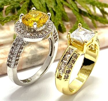 Lot of 2: 1.10ctw White Sapphire Ring Size 6 & 2.38ctw Yellow & White Topaz Ring size 7