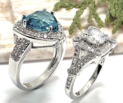 Lot of 4.30ctw Blue Topaz & White Sapphire Ring Size 7 & 1.50ctw White Sapphire Ring Size 6 3/4