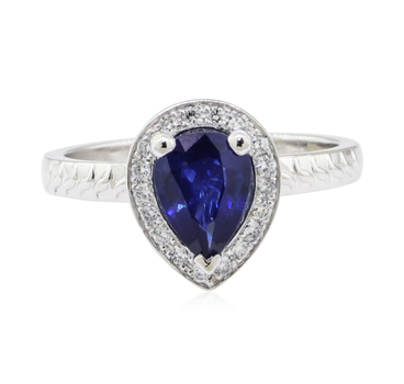 Platinum 6.05 Grams Pear Shape Halo Style Diamond Ring With Sapphire Center
