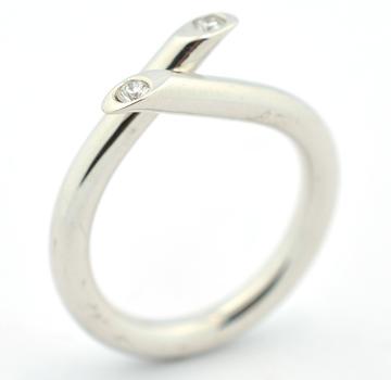 Platinum 10.66 Grams Round Diamond Crossover Ring