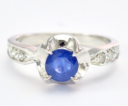 14K White Gold 4.13 Grams 0.30 Carat t.w. Diamond Ring With 1.09 Carats t.w. Sapphire Center