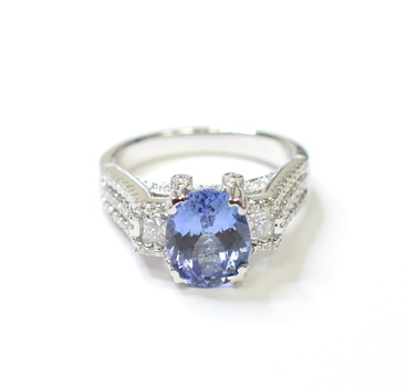 18K White Gold 6.80 Grams 0.82 Carats t.w. Round & Princess Cut Diamond Ring With Tanzanite Center Stone