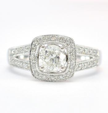 18K White Gold 3.50 Grams 0.82 Carat t.w. Diamond Halo Style Split Shank Lady's Ring