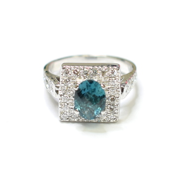 14K White Gold 5.40 Grams 1.00 Carats t.w. Round Diamond Ring With Oval Cut Blue Topaz Center