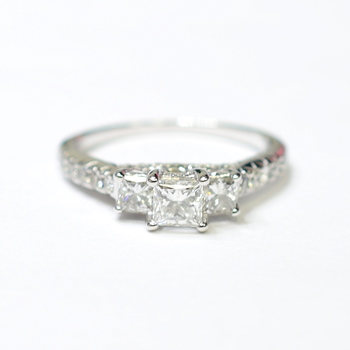 14K White Gold 3.70 Grams 1.29 Carats t.w. Round Diamond Ring With 3-Stone Princess Cut Center Stones