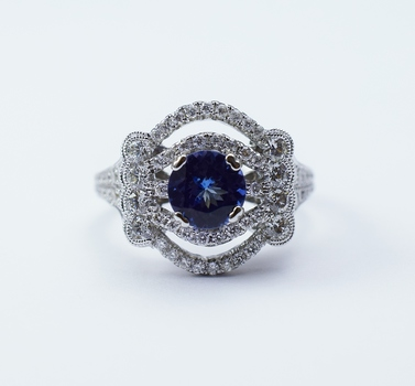 18K White Gold Round Diamond Ring With Round Cut Tanzanite Center