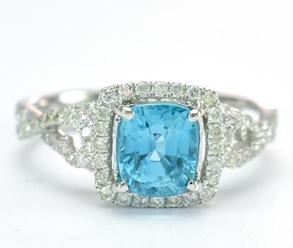 14K White Gold 3.20 Grams Diamond Halo Style Ring With Blue Zircon Center Stone
