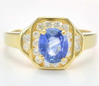 14K Yellow Gold 3.60 Grams Diamond Lady's Ring With 1.00 Carat Tanzanite Center Stone