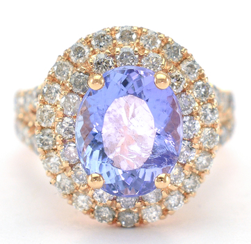 14K Rose Gold 9.0 Grams 1.59 Carats t.w. Diamond Double Halo Style Ring With 4.30 Carats Tanzanite Center Stone