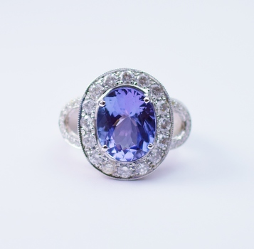 18K White Gold 16.40 Grams Round Diamond Oval Halo Style Split Shank Ring With Oval Cut Tanzanite Center