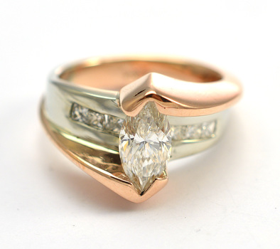 14K Two Tone Gold 9.82 Grams Diamond Cocktail Ring With 1.25 Carats Marquise Cut Diamond Center
