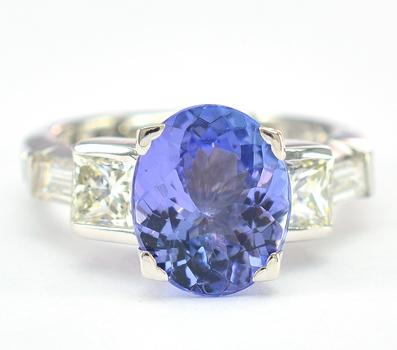 Platinum 9.40 Grams Diamond Lady's Ring with Tanzanite Center Stone