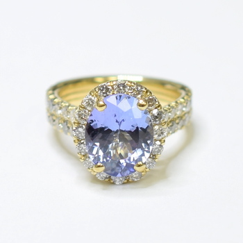 14K Yellow Gold Oval Halo Style Diamond Ring With Tanzanite Center Stone