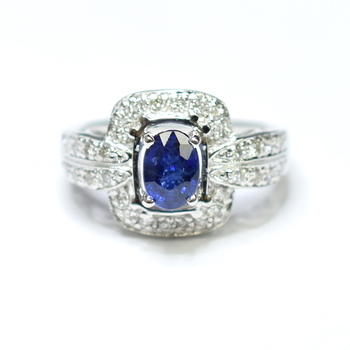 14K White Gold 5.20 Grams Halo Style Diamond Ring With 1.40 Carats Oval Sapphire Center Stone