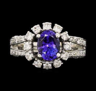 18K White Gold Round Diamond Round Halo Style Ring With Oval Cut Tanzanite Center