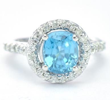 14K White Gold 5.30 Grams Diamond Halo Style Ring With Blue Zircon Center Stone