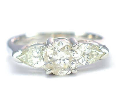 14K White Gold 3.70 Grams 1.25 Carats t.w. Pear and Round Diamond Three Stone Ring