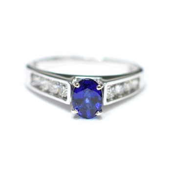 14K White Gold 3.60 Grams Channel Set Round Diamond Ring With Sapphire Center Stone