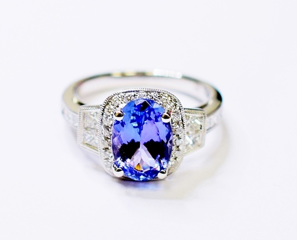 18K White Gold 6.30 Grams Halo Style Diamond Ring With Tanzanite Center Stone