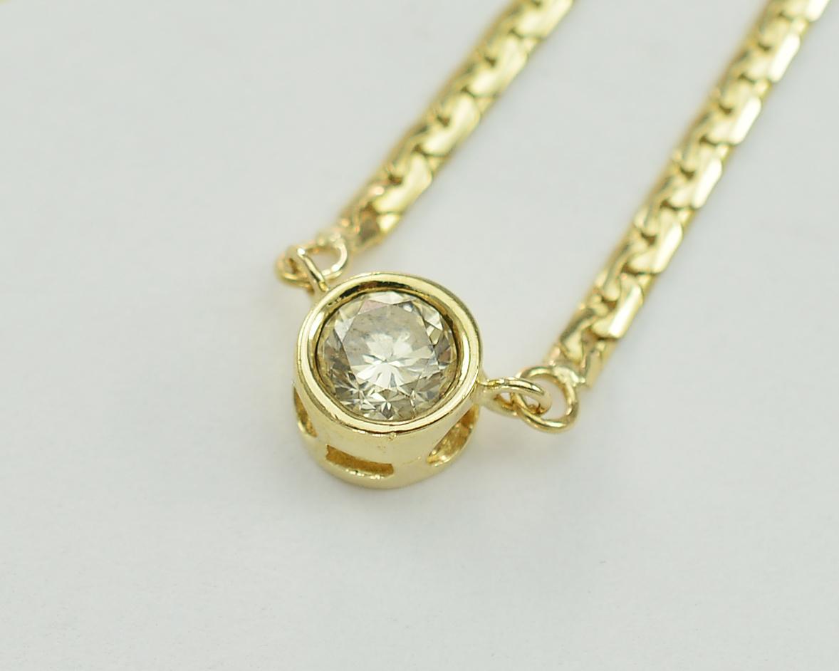 14k Yellow Gold Bezel Set Brilliant 0 60 Carat Diamond