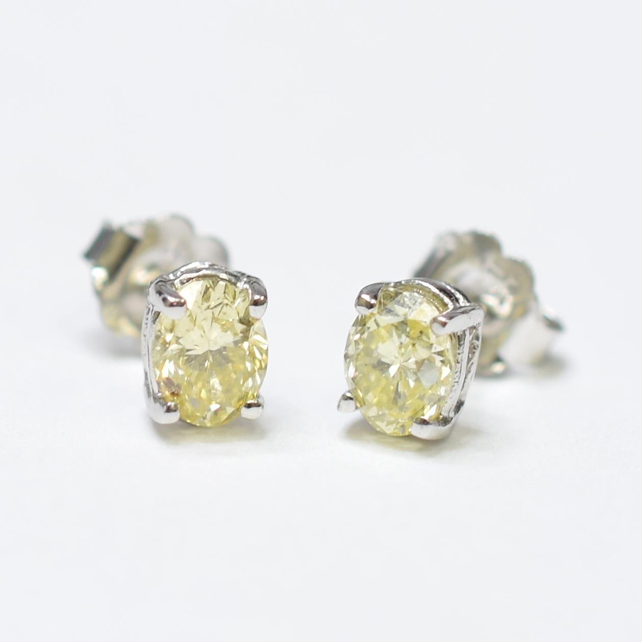 5cc66b9ec Image 1 of 4. 14K White Gold 1.15 Grams 1.21 Carats t.w. Oval Shape Fancy  Yellow Diamond Stud Style Earrings