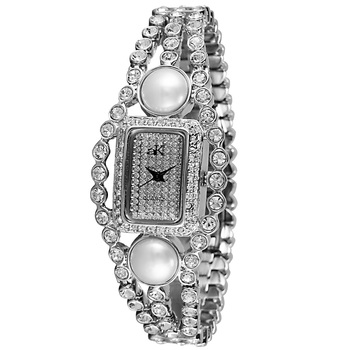 AUSTRIAN CRYSTAL AND WHITE PEARL ACCENT, MIYOTA QUARTZ MOVEMENT,  AK9-70L, RETAIL AT $450.00