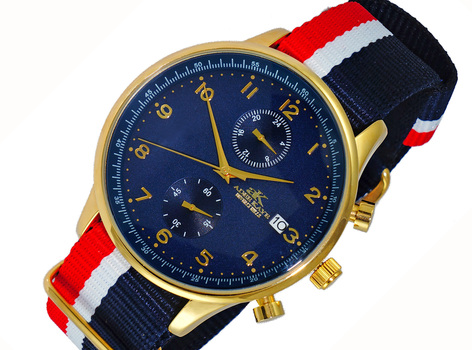 DUAL TIME OF 24 HOUR REGULATOR, GOLD TONE CASE. AK7501-MGBU-NYB, RETAIL AT $245.00