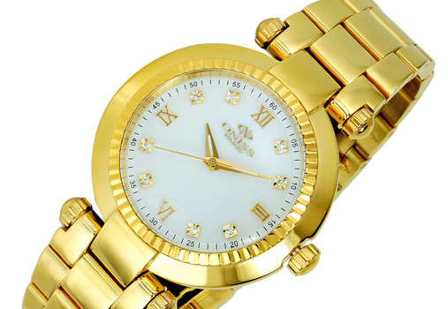 SWISS MOVEMENT, MOTHER OF PEARL DIAL, GOLDTONE ON615-LGWT - ETAIL AT  (MSRP: $500.00)