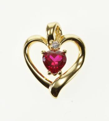 10K Heart Cut Ruby* Diamond Accented Wavy Heart Yellow Gold Pendant