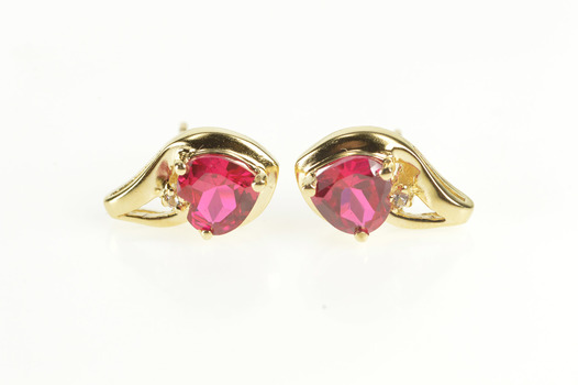 10K Heart Cut Sim. Ruby Diamond Accent Stud Yellow Gold Earrings