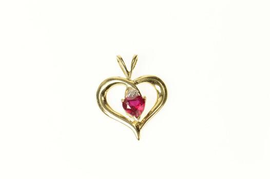 10K Heart Syn. Ruby Diamond Accent Love Yellow Gold Pendant