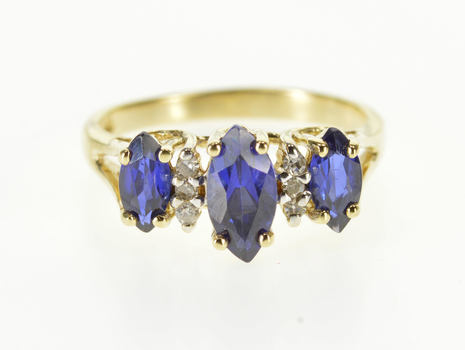 10K Marquise Sapphire* Diamond Accent Three Stone Yellow Gold Ring, Size 4.75