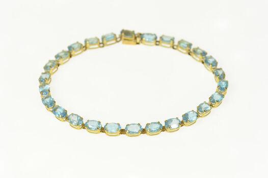 "10K Oval Blue Topaz Classic Tennis Yellow Gold Bracelet 7"""