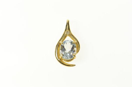 10K Oval Blue Topaz Diamond Accent Statement Yellow Gold Pendant
